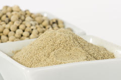 White pepper grain and powder Stock Images