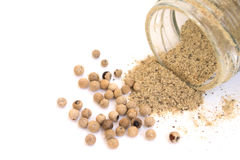 White pepper powder and seed. From the Bottle Royalty Free Stock Image