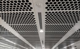 White perforated ceiling stock photography