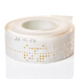 White perforated punched tape with old data  is isolated on back. Ground, close up Stock Photo