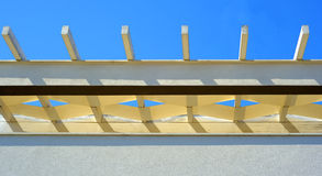 White pergola roof beans and blue sky Royalty Free Stock Photography