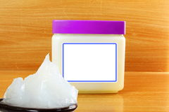 White petroleum jelly in spoon with jar Royalty Free Stock Photos