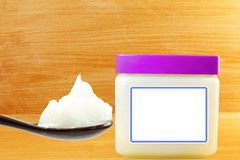 White petroleum jelly in spoon with jar Royalty Free Stock Photography