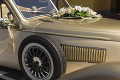 White petunias on the balcony. A bouquet of flowers on the hood of a retro wedding car Stock Photos