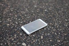 White phone with broken screen Stock Photos