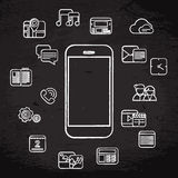 White phone icons. Set on grunge blackboard background Stock Photography