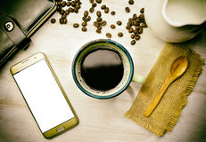 White phone screen and cup of coffee Royalty Free Stock Photos