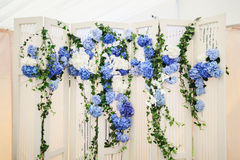 White photo-booth with blue hydrangeas Royalty Free Stock Photo