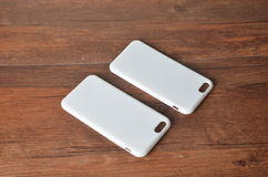White photo case at hte wood background Royalty Free Stock Photography