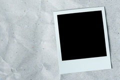 White photo frame on white texture paper background. Stock Image
