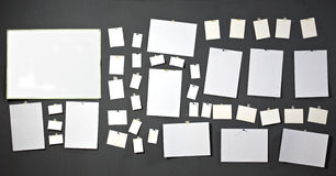 White photo paper. Attach to gray wall Royalty Free Stock Photo
