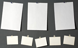 White photo paper. Attach to gray wall Stock Photography