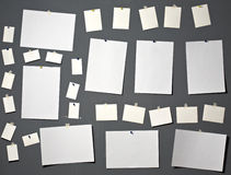 White photo paper. Attach to gray wall Royalty Free Stock Images
