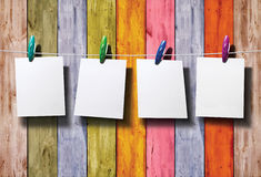 White photo paper on wooden fence. White photo paper on colorful wooden fence Stock Photography