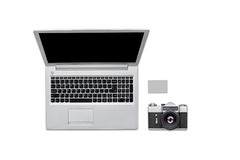 White photographer desk table with retro camera, laptop and blank card. Top view with copy space, flat lay. Modern computer and ol Stock Photography