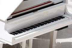 White piano. In the room stock images