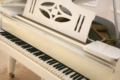 White piano. Close up of white piano stock photo
