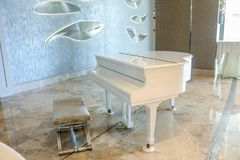 White piano in a white interior and luxury room. Royalty Free Stock Image