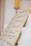 White piano with notes Stock Image