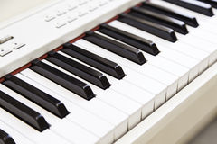 White piano on stage Stock Images