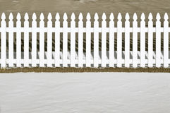White picket fence. With snow in the foreground Stock Photography