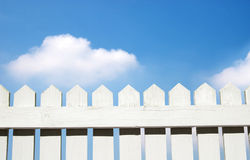 White picket fence. And blue sky Stock Photography