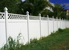 White Picket Fence. Along condos on island Stock Photo