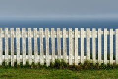 White picket fence. Along the Atlantic Ocean at Cape Spear in St. John's, Newfoundland Royalty Free Stock Images