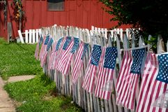 White Picket Fence. Decorated with American flags Stock Image