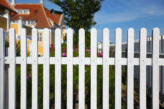 White picket fence. Traditionally surrounding the house Stock Photos