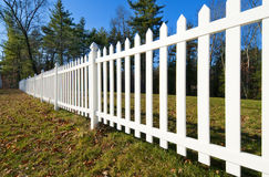 White picket fence. White fence separating a house yard from the road Stock Photography