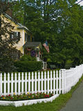 White Picket Fence. A white picket fence surrounds a country home located in rural North Wester, New Jersey Stock Photos