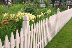 White Picket Fence. Along side a perennial flower garden stock photo