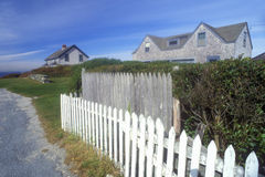 White picket fence along Route 77 in Sakonnet, RI Stock Photography