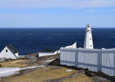 White picket fence and Cape Spear lighthouse Stock Image