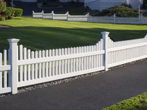 White picket fence Stock Images