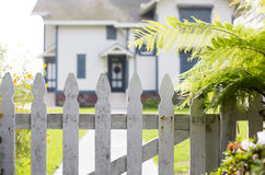 White picket fence and an entrance Stock Photography