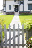 White picket fence and an entrance Stock Photo