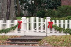 White Picket Fence, Garland, and Red Bow III Royalty Free Stock Image