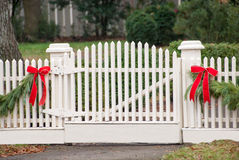 White Picket Fence, Garland, and Red Bow IV Royalty Free Stock Image