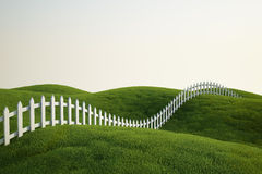 White picket fence on grass Royalty Free Stock Photography