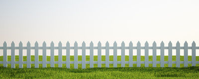 White picket fence on grass Royalty Free Stock Image