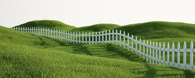 White picket fence on grass Stock Image