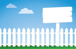 White picket fence with a sign Stock Photography