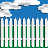 White Picket Fence With Clouds Stock Photography