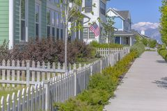 White picket fences on yards with sidewalk. In Utah Valley neighborhood royalty free stock photography