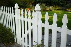 White Picket Fennce. White Picket Fence entering front yard Stock Photos