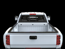 White pickup truck - back view. Isolated on black background royalty free stock photos