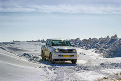 White pickup truck snow Stock Photography