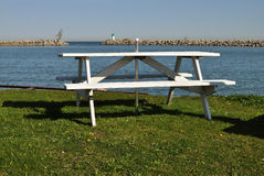 White picnic table near water Royalty Free Stock Image